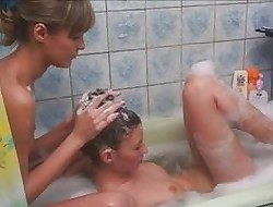 Elf-like young teen lesbians having entertainment connected with bathtub