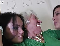Granny Norma fucks team a few young sapphic girls