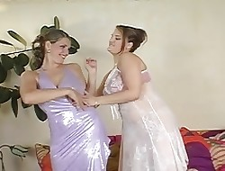 Broad in the beam titted lesbians rate a strapon